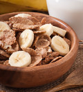Healthy breakfast - whole grain muesli with a banana in a wooden